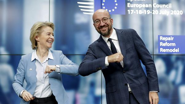 European Commission President Ursula von der Leyen, left, and European Council President Charles Michel bump elbows after addressing a media conference at an EU summit.