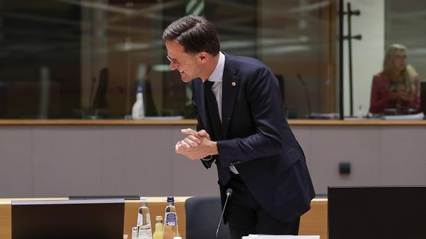 Dutch Prime Minister Mark Rutte smiles during a round table meeting at an EU summit in Brussels