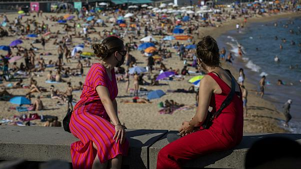 Two women look at the beach in Barcelona, Spain