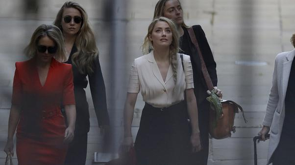 Actress Amber Heard arrives at the High Court, in London, Monday, July 20, 2020.