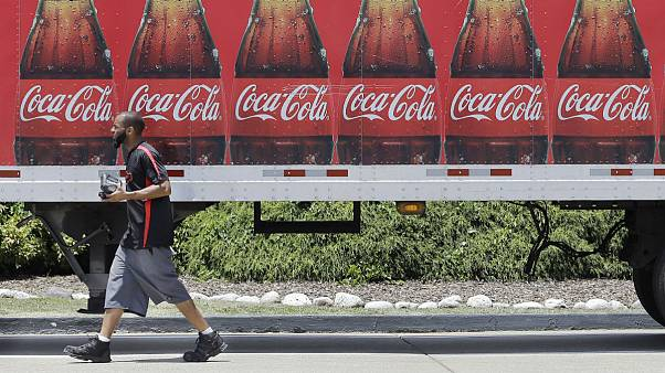 A worker delivers Coca Cola products in Nashville, Tenn
