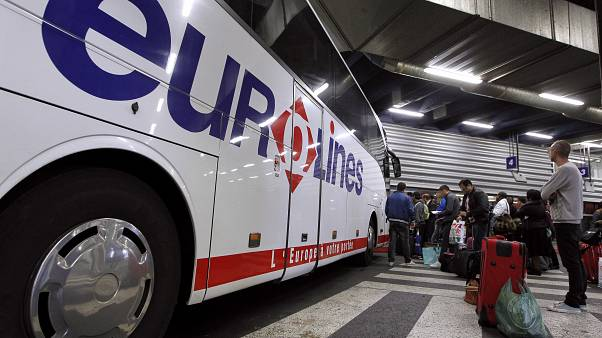 Passengers wait to board a Eurolines bus in France. 6 April, 2012.
