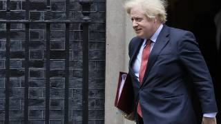 Britain's Prime Minister Boris Johnson leaves 10 Downing Street to attend the weekly session of PMQs in Parliament in London, Wednesday, June 10, 2020.