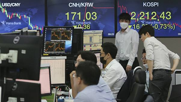 Currency traders watch monitors at the foreign exchange dealing room of the KEB Hana Bank headquarters in Seoul, South Korea