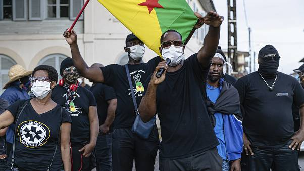Masked protestors gathered in front of the Prefecture of Guiana during a meeting about the department's COVID-19 response.
