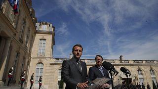 الرئيس الفرنسي إيمانويل ماكرون مع نظيره القبرصي نيكوس أناستسيادس