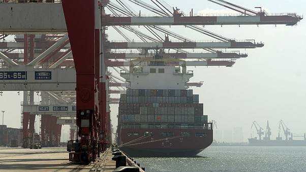A cargo ship is docked a port in Yingkou in northeastern China's Liaoning Province