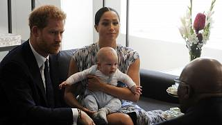Prince Harry and Meghan, Duchess of Sussex, holding their son Archie.