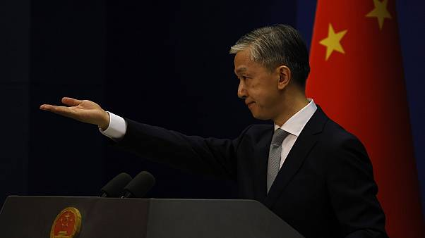 Foreign Ministry spokesperson Wang Wenbin gestures for questions during a daily briefing in Beijing.