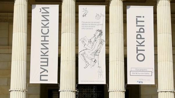"Banners at front of museum reading (Russian): ""Pushkin (museum) Open"""
