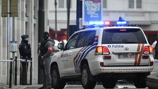 Police patrol a street in Brussels outside a courtroom during a hearing of suspect terrorist Salah Abdeslam