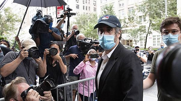 Michael Cohen, Donald Trump's former personal lawyer, returns to his apartment after being released from prison.