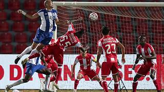 Porto's Pepe, left, jumps for the ball with CD Aves' Estrela during the Portuguese League soccer match between CD Aves and FC Porto