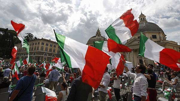 People wave Italian flags during a centre-right opposition rally in Rome's central Piazza del Popolo on July 4, 2020.