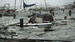 Loose and damaged boats are tossed around after the docks at the marina where they had been secured were destroyed as Hurricane Hanna made landfall