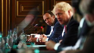 Britain's Health Secretary Matt Hancock (L) and Britain's Prime Minister Boris Johnson at the Foreign and Commonwealth office in London on July 21, 2020.