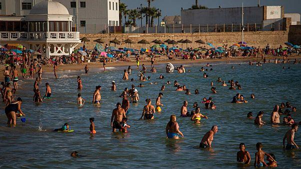 Bathers enjoy the beach in Cadiz, south of Spain, on Friday, July 24, 2020.