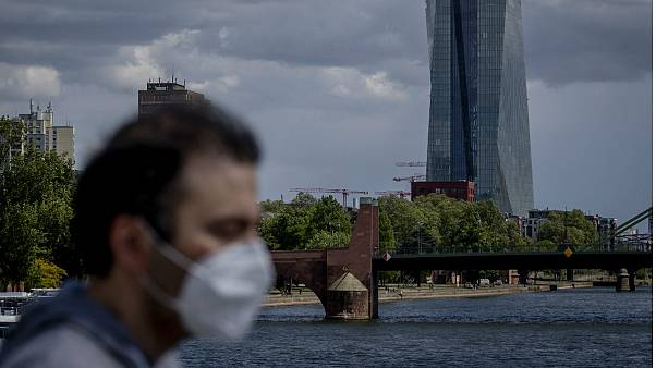A man walks in front of the European Central Bank in Frankfurt, Germany