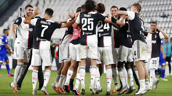 Juventus players celebrate at the end of Serie A soccer match between Juventus and Sampdoria at the Allianz stadium, in Turin.