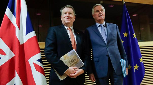 EU chief Brexit negotiator Michel Barnier, right, speaks with the British Prime Minister's Europe adviser David Frost during Brexit trade talks, Brussels, July 9, 2020.