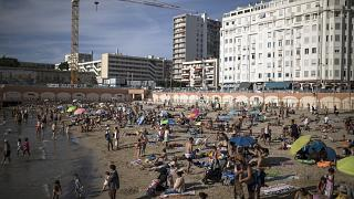 Beachgoers enjoy the sun at the Plage des Catalans in Marseille, southern France, July 25, 2020.