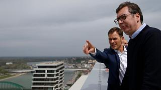 In this Friday, April 5, 2019, photo, Serbia's finance minister Sinisa Mali, left, speaks with Serbia's President Aleksandar Vucic in Belgrade, Serbia