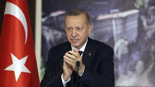 President Recep Tayyip Erdogan is applauding lawmakers' final speeches on a bill giving the government greater powers to regulate social media