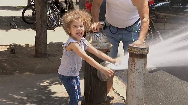 New York City has opened up hundreds of fire hydrants to help locals cope with hot temperatures.