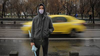 A man wears a mask during an anti-pollution protest outside the city hall in Bucharest, Romania