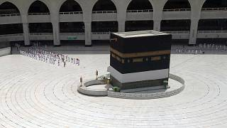 Muslim pilgrims line up to leave after they circled the Kaaba, the cubic building at the Grand Mosque,