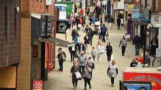 Shoppers in central Rochdale, greater Manchester
