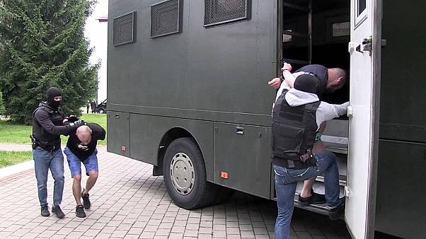 In this photo taken from video released by Belarusian KGB, State TV and Radio Company of Belarus on Wednesday, July 29, 2020, Belarusian KGB officers detain Russian men.