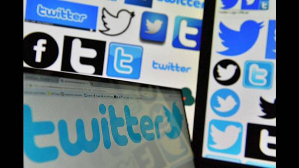 Logos of Twitter displayed on computers' screens
