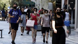People with masks in downtown Athens
