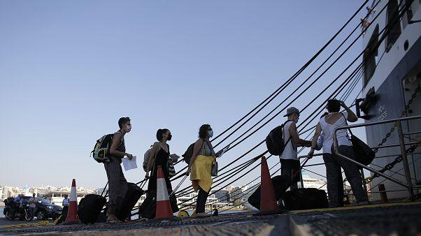 People departing from Piraeus port