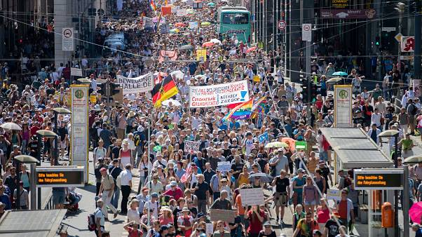 Thousands march along the 'Friedrichstrasse' during the demonstration against coronavirus measures in Berlin