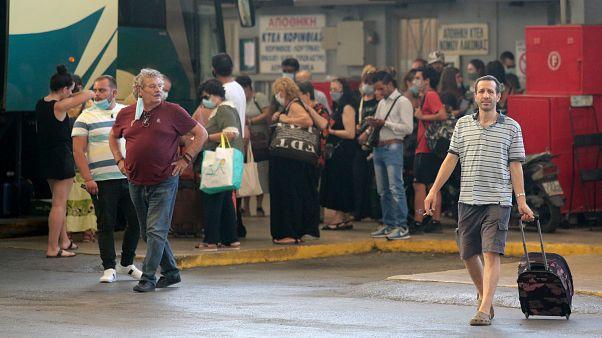 People boarding buses in Greece