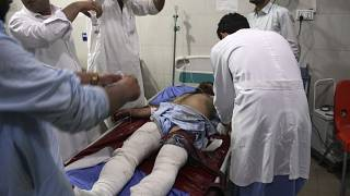 A wounded man receives treatment at a hospital after a suicide car bomb and multiple gunmen attack in the city of Jalalabad, east of Kabul, Afghanistan, Sunday, Aug. 2, 2020.