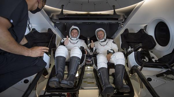 NASA astronauts Robert Behnken, left, and Douglas Hurley are seen inside the SpaceX Crew Dragon Endeavour spacecraft shortly after landing in the Gulf of Mexico, 02/08/2020.