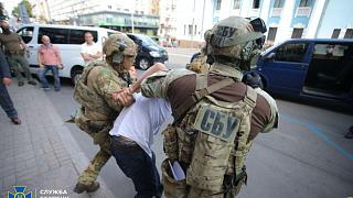 Officers from Ukraine's Security Service detain a man who threatened to blow up a bank in Kyiv on Monday, August 3, 2020.