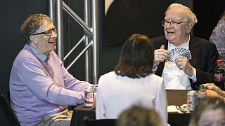 Berkshire Hathaway Chairman and CEO Warren Buffett, right, plays bridge with Microsoft co-founder, Bill Gates