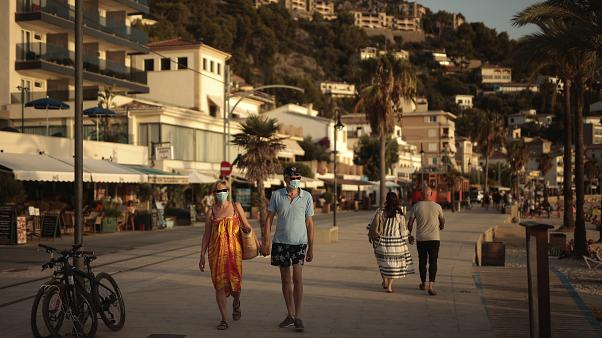 Tourists and locals walk in town of Sóller in the Balearic Island of Mallorca, Spain