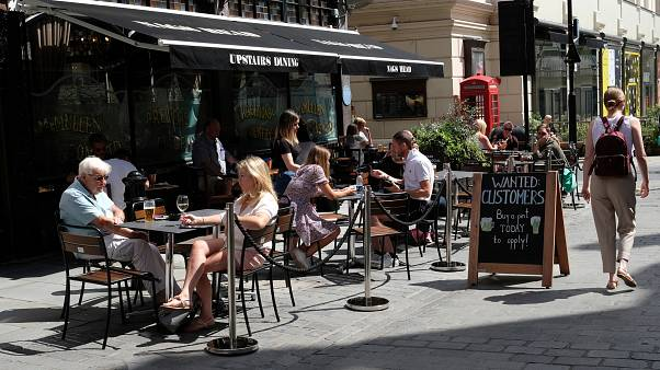 """A sign outside a pub that reads: """"Wanted Customers"""" in central London"""