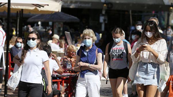 Tourists wearing masks visit Saint Malo, Brittany,