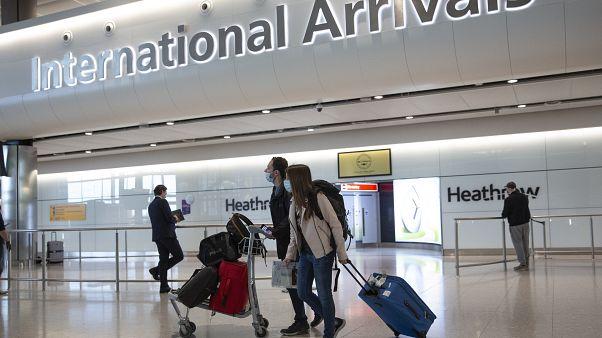 Passengers arrive at London's Heathrow Airport on June 8, 2020.