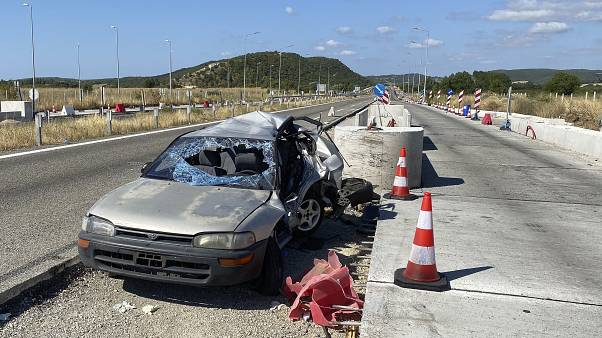 A damaged car sits in toll stations still under construction in the village of Ardanio, near Alexandroupolis