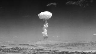 In this April 22, 1952 file photo a gigantic pillar of smoke with the familiar mushroom top climbs above Yucca Flat, Nev. during nuclear test detonation.