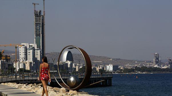 A woman walks across the sea in southern coastal city of Limassol, Cyprus