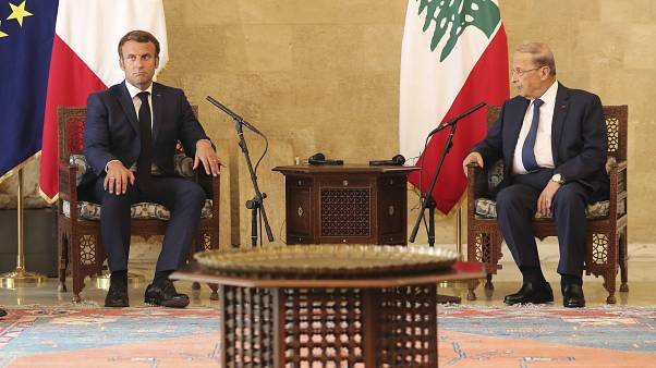 French President Emmanuel Macron, left, and Lebanese President Michel Aoun at Beirut airport