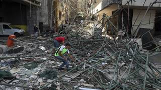 Workers remove rubble from damaged buildings near the site of an explosion on Tuesday that hit the seaport of Beirut, Lebanon, Thursday, Aug. 6, 2020.